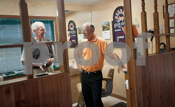 Woody Woodall, left, pays for his last haircut from Tony Carter, right, at Tony's Barber Shop Wednesday Oct. 28, 2015. It was Carter's last day of work before retiring from the shop, located at 16355 Farm-to-Market 344 next to the Emerald Bay subdivision. Carter has been a barber for 52 years and 10 months.  (Sarah A. Miller/Tyler Morning Telegraph)