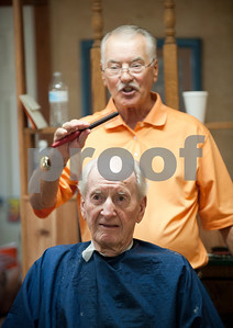 Barber Tony Carter cuts Woody Woodall's hair at Tony's Barber Shop Wednesday Oct. 28, 2015. It was Carter's last day of work before retiring from the shop, located at 16355 Farm-to-Market 344 next to the Emerald Bay subdivision. Woodall was Carter's final customer. Carter had a barbering career of 52 years and 10 months.  (Sarah A. Miller/Tyler Morning Telegraph)