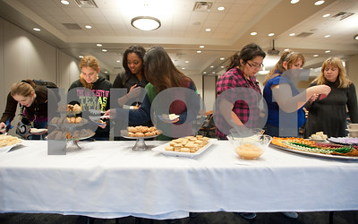 photo by Sarah A. Miller/Tyler Morning Telegraph  Students try small sandwiches, scones and tea during Afternoon Tea, a special International Education Week event held Monday at the University of Texas at Tyler where students and staff tried various teas and small snacks such as scones and clotted cream. shortbread cookies. UT Tyler is holding special campus events to celebrate International Education Week Nov. 12 – 16. Other events include a Global Quiz Night Tuesday evening and a Henna, Dress and Adornment workshop Wednesday morning.