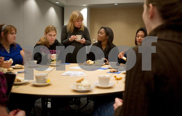 photo by Sarah A. Miller/Tyler Morning Telegraph  University of Texas at Tyler director of the Center for Global Education Jill Blondin spends time with students at the Afternoon Tea event Monday at UT Tyler. Afternoon tea is a British custom from the 1840s. It consists of a small snack eaten between 3p.m. and 5p.m. The event was one of several special events celebrating International Education Week.