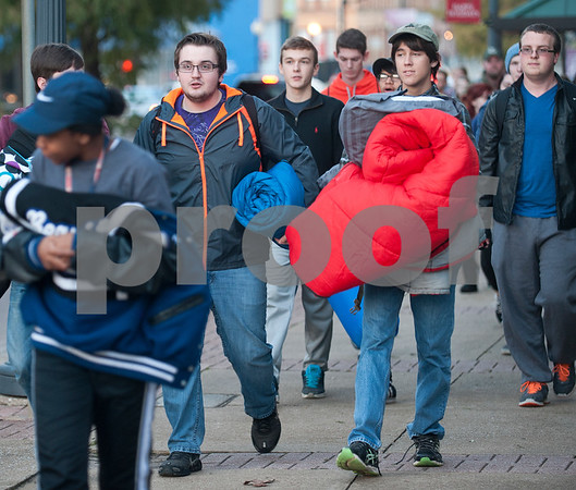 Tyler Junior College students Caleb McFarland and Timothy Brown carry their sleeping bags as they walk from The Salvation Army to Bergfeld Park in Tyler, Texas for the annual One Night Without A Home event Thursday Nov. 12, 2015. Participants in the event spend the night at the park to give them a better idea of life as a homeless person.   (Sarah A. Miller/Tyler Morning Telegraph)
