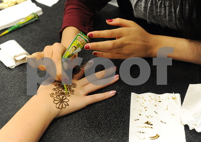 photo by Sarah A. Miller/Tyler Morning Telegraph  University of Texas at Tyler student freshman Haley Fincher of Wills Point has a henna tattoo made on her hand by freshman Zee Shahid of Houston at the Henna, Dress and Adornment Workshop held Wednesday at UT-Tyler. Henna tattoos are temporary tattoos that women in the eastern Mediterranean wear as part of social and holiday celebrations.