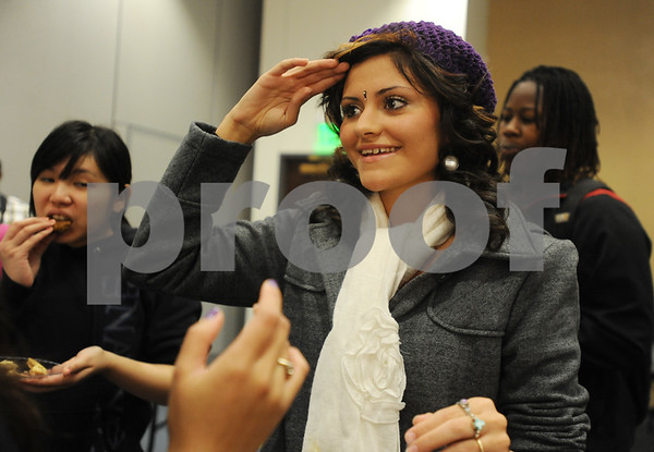 photo by Sarah A. Miller/Tyler Morning Telegraph  University of Texas at Tyler freshman Khaliah Al-Noimi of Whitehouse wears a bindi on her forehead at the Henna, Dress and Adornment Workshop held Wednesday at UT-Tyler. A bindi is a piece of jewelry worn between the eyebrows in South Asia and Southeast Asia. The event was a part of International Education Week sponsored by the Center for Global Education.