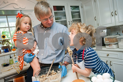 """photo by Sarah A. Miller/Tyler Morning Telegraph  Tom Brown of Tyler has help from his grandchildren Ellie Butts, 3, and Will Butts, 6, as they make a batch of cookies for the family Nov. 14, 2013. Brown, an attorney, regularly gives the cookies away for clients at the law office, for the nurses when visiting people at the hospital, for accountants during tax season and for friends, family and fundraisers. """"In some ways, it became a ministry and calling, and a way to serve other people,"""" he said."""