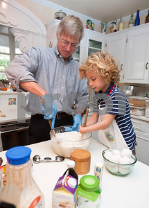 """photo by Sarah A. Miller/Tyler Morning Telegraph  Tom Brown of Tyler has help from his grandson Will Butts, 6, as they make a batch of cookies for the family Nov. 14, 2013. Brown, an attorney, regularly gives the cookies away for clients at the law office, for the nurses when visiting people at the hospital, for accountants during tax season and for friends, family and fundraisers. """"In some ways, it became a ministry and calling, and a way to serve other people,"""" he said."""