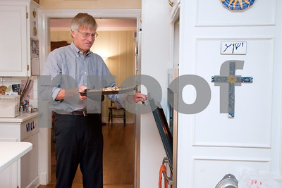"""photo by Sarah A. Miller/Tyler Morning Telegraph  Tom Brown of Tyler takes a fresh batch of Tom Brown cookies out of the oven of his house Nov. 14, 2013. Brown, an attorney, regularly gives the cookies away for clients at the law office, for the nurses when visiting people at the hospital, for accountants during tax season and for friends, family and fundraisers. """"In some ways, it became a ministry and calling, and a way to serve other people,"""" he said."""