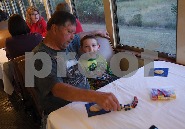Michael Moore of Rusk and Dylan Starkey, 5, ride the Polar Express train at the Texas State Railroad in Palestine Monday Nov. 15, 2016. The hour long Polar Express trip runs Nov. 18-22, 25-27; Dec. 2-4, 9-11, 13-23.    (Sarah A. Miller/Tyler Morning Telegraph)