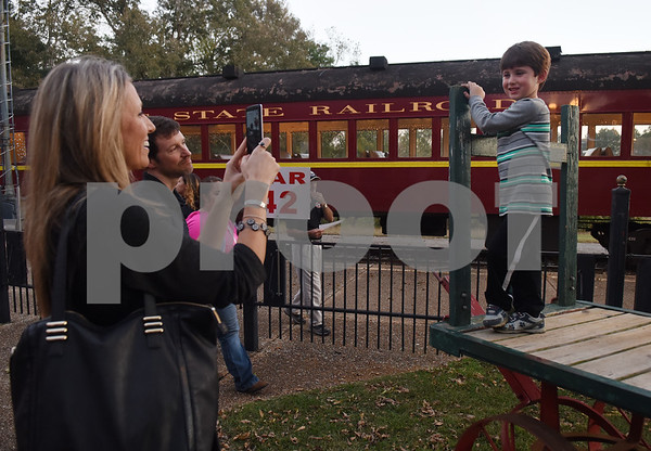 Stephanie Nimitz of Rusk takes a photo of her son Nate Nimitz, 4, before riding the Polar Express train at the Texas State Railroad in Palestine Monday Nov. 15, 2016. The hour long Polar Express trip runs Nov. 18-22, 25-27; Dec. 2-4, 9-11, 13-23.    (Sarah A. Miller/Tyler Morning Telegraph)
