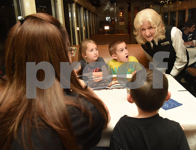 Joyce Jones visits with the Parsons family of Rusk during the Polar Express train ride at the Texas State Railroad in Palestine Monday Nov. 15, 2016. Pictured from left: Amy Parsons, Bailey Parsons, 6, Hunter Parsons, 8, and Luke Parsons, 4.  (Sarah A. Miller/Tyler Morning Telegraph)