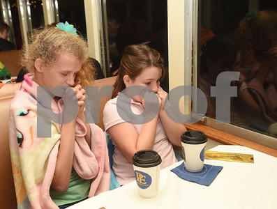 Channa Gibson, 13, and Emilie Morris, 9, wish for Santa to board their train car during the Polar Express train ride at the Texas State Railroad in Palestine Monday Nov. 15, 2016.   (Sarah A. Miller/Tyler Morning Telegraph)