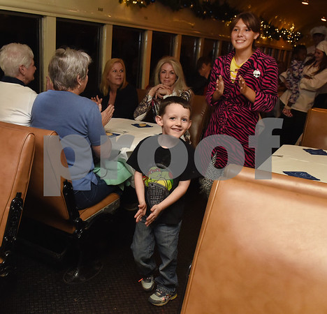 Luke Parsons, 4, of Rusk, and Mary Goff, 12, of Alto, dance down the aisle of their train car during the Polar Express train ride at the Texas State Railroad in Palestine Monday Nov. 15, 2016.   (Sarah A. Miller/Tyler Morning Telegraph)