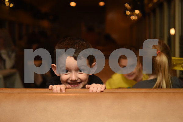 Luke Parsons, 4, of Rusk, peers over his seat during the Polar Express train ride at the Texas State Railroad in Palestine Monday Nov. 15, 2016.   (Sarah A. Miller/Tyler Morning Telegraph)