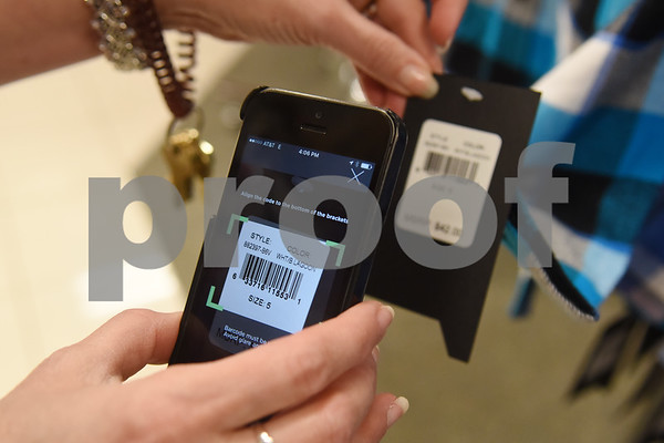 Kohl's store manager Janie Mayo holds demonstrates the new Kohl's app at her store in Tyler Tuesday Nov. 16, 2016. Kohl's now has extended holiday shopping hours and a smartphone app for customers.  (Sarah A. Miller/Tyler Morning Telegraph)