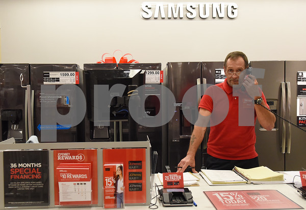 Appliance supervisor Doug Whitfield takes a phone call at J.C. Penney in Tyler Friday Nov. 18, 2016. J.C. Penney will open Thanksgiving Day at 3 p.m. for their Black Friday sale.   (Sarah A. Miller/Tyler Morning Telegraph)