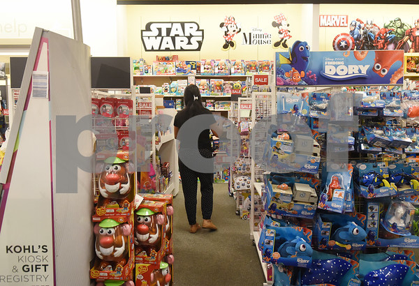 Employee Jessica Cornelio works in the toys section at Kohl's in Tyler Tuesday Nov. 16, 2016. Kohl's now has extended holiday shopping hours and a smartphone app for customers.  (Sarah A. Miller/Tyler Morning Telegraph)