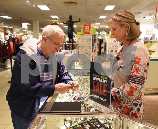 Troy Tadlock of Bullard is assisted at the watch counter by employee Debbie Byford at J.C. Penney in Tyler Friday Nov. 18, 2016. J.C. Penney will open Thanksgiving Day at 3 p.m. for their Black Friday sale.   (Sarah A. Miller/Tyler Morning Telegraph)