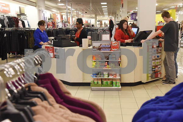 Customers make purchases at J.C. Penney in Tyler Friday Nov. 18, 2016. J.C. Penney will open Thanksgiving Day at 3 p.m. for their Black Friday sale.   (Sarah A. Miller/Tyler Morning Telegraph)