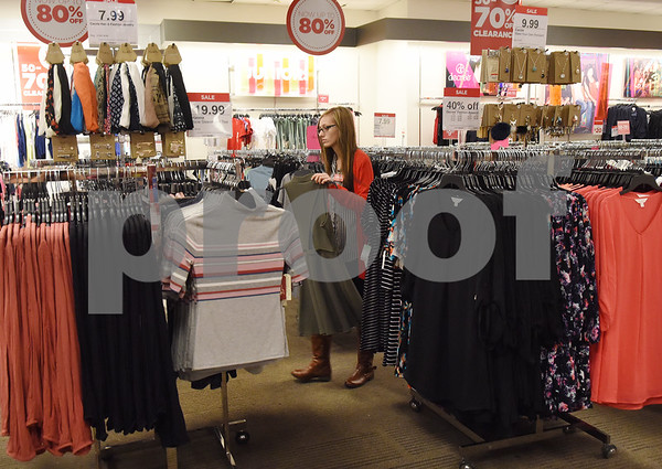 Employee Megan Shuptrine works in the Juniors section at J.C. Penney in Tyler Friday Nov. 18, 2016. J.C. Penney will open Thanksgiving Day at 3 p.m. for their Black Friday sale.   (Sarah A. Miller/Tyler Morning Telegraph)