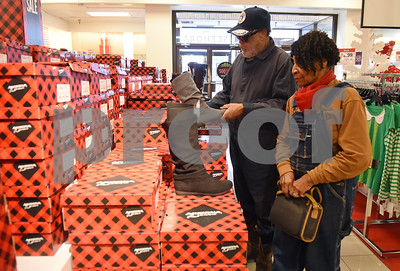 Alfred and June Henry of Tyler shop in the boots sections at J.C. Penney in Tyler Friday Nov. 18, 2016. J.C. Penney will open Thanksgiving Day at 3 p.m. for their Black Friday sale.   (Sarah A. Miller/Tyler Morning Telegraph)