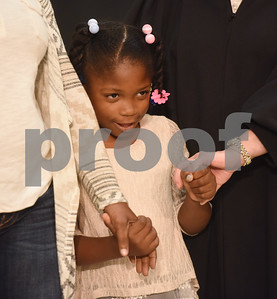 Shazmine Henderson, 6, of Carthage, is adopted during an adoption event held by the Texas Department of Family and Protective Services at Rose Heights Church in Tyler Friday Nov. 18, 2016. November is National Adoption Awareness Month.  (Sarah A. Miller/Tyler Morning Telegraph)