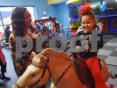 Alex Way, of Tyler, spends time with her newly adopted sister Amiya Bell, 3, during an adoption event held by the Texas Department of Family and Protective Services at Rose Heights Church in Tyler Friday Nov. 18, 2016. November is National Adoption Awareness Month.  (Sarah A. Miller/Tyler Morning Telegraph)