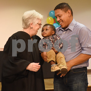 Judge Carole Clark visits with Rafael Gonzalez of Jacksonville and his newly adopted son Isaiah Daniel, 1, during an adoption event held by the Texas Department of Family and Protective Services at Rose Heights Church in Tyler Friday Nov. 18, 2016. November is National Adoption Awareness Month.  (Sarah A. Miller/Tyler Morning Telegraph)