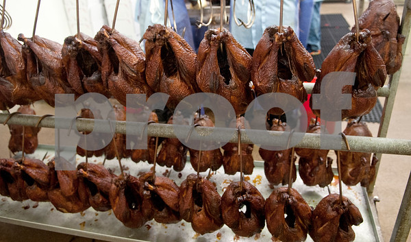 Smoked turkeys wait on racks to be packaged for shipping at Greenberg Smoked Turkey Inc. in Tyler, Texas Wednesday Nov. 11, 2015. Greenberg Smoked Turkey is a family-run business selling slow cooked hickory smoked turkeys seasoned with a family spice recipe.  (Sarah A. Miller/Tyler Morning Telegraph)
