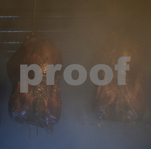 Turkeys cook hanging inside a smokehouse at Greenberg Smoked Turkey Inc. in Tyler, Texas Wednesday Nov. 11, 2015. Greenberg Smoked Turkey is a family-run business selling slow cooked hickory smoked turkeys seasoned with a family spice recipe.  (Sarah A. Miller/Tyler Morning Telegraph)