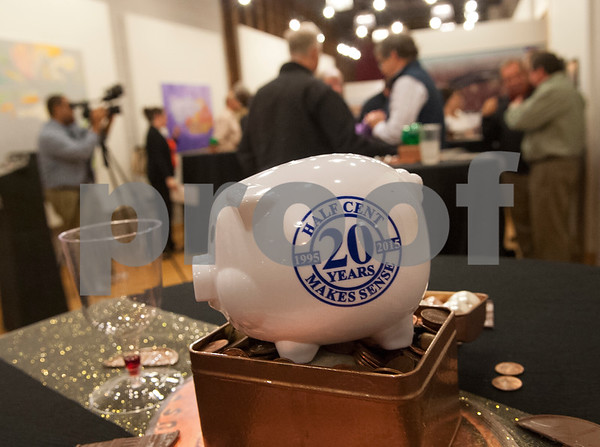 Piggy banks decorate tables at a reception at Main Street Gallery Thursday for the 20th anniversary of Tyler voters approving the half-cent sales tax. Tyler adopted the half-cent sales tax in 1995. Each year, it collects approximately $13 million in half-cent sales tax revenues, which has allowed the city to pay cash for capital improvements.   (Sarah A. Miller/Tyler Morning Telegraph)