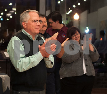 Tyler city councilman Don Warren applauds during a reception at Main Street Gallery Thursday for the 20th anniversary of Tyler voters approving the half-cent sales tax. Tyler adopted the half-cent sales tax in 1995. Each year, it collects approximately $13 million in half-cent sales tax revenues, which has allowed the city to pay cash for capital improvements.   (Sarah A. Miller/Tyler Morning Telegraph)