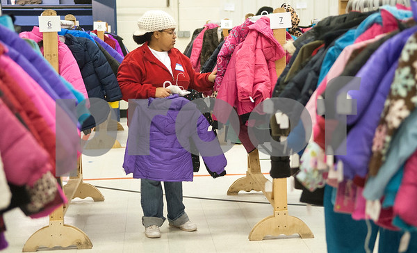 Volunteer Helena Coleman picks out winter coats for children to try on during PATH Coats for Kids at the North Tyler Day Nursery gymnasium, 3000 N. Border Ave. Saturday Nov. 21, 2015. PATH handed out new and gently-used coats to Smith County children and teens in need. Over 1,000 children were preregistered to receive coats Saturday.  (Sarah A. Miller/Tyler Morning Telegraph)