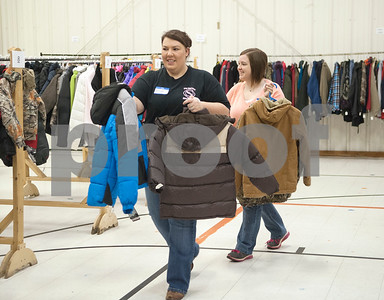 Volunteers Savana Foster and Kristin Rogers pic out winter coats for children to try on during PATH Coats for Kids at the North Tyler Day Nursery gymnasium, 3000 N. Border Ave. Saturday Nov. 21, 2015. PATH handed out new and gently-used coats to Smith County children and teens in need. Over 1,000 children were preregistered to receive coats Saturday.  (Sarah A. Miller/Tyler Morning Telegraph)