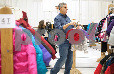 Volunteer Bill Rogers finds toddler and infant sized coats for a family attending PATH Coats for Kids at the North Tyler Day Nursery gymnasium, 3000 N. Border Ave. Saturday Nov. 21, 2015. PATH handed out new and gently-used coats to Smith County children and teens in need. Over 1,000 children were preregistered to receive coats Saturday.  (Sarah A. Miller/Tyler Morning Telegraph)