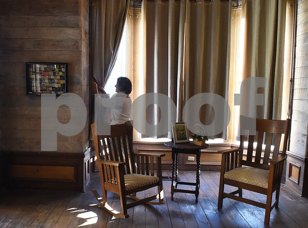 Margaret Perkins pulls back the curtains at the historic James I. Perkins Family Home is pictured in Rusk Monday Nov. 14, 2016.  (Sarah A. Miller/Tyler Morning Telegraph)