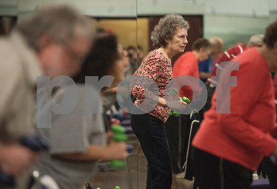 Charlene Goodman of Flint uses wights during a Silver Sneakers exercise class for seniors at Premier Fitness in Tyler Nov. 21, 2016.  (Sarah A. Miller/Tyler Morning Telegraph)