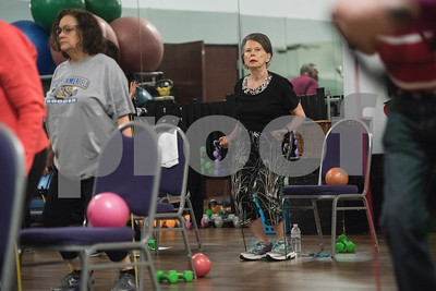 Carole Haberle of Tyler uses a band during a Silver Sneakers exercise class for seniors at Premier Fitness in Tyler Nov. 21, 2016.  (Sarah A. Miller/Tyler Morning Telegraph)