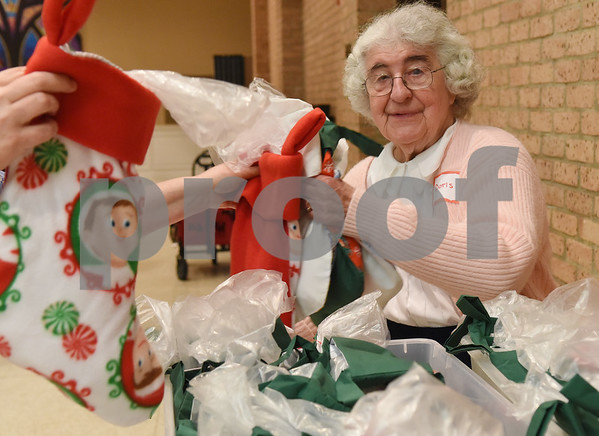 Doris Bearr organizes finished stockings Tuesday night at Marvin United Methodist Church. The 525 hand made stockings will be given to children at St. Paul Children's Foundation in Tyler for Christmas.  (Sarah A. Miller/Tyler Morning Telegraph)