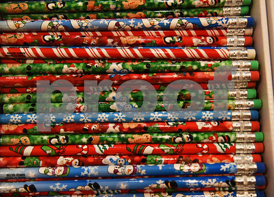 Stockings filled Tuesday night at Marvin United Methodist Church for St. Paul Children's Foundation contain pencils such as these as well as toys, toothbrushes and more.  (Sarah A. Miller/Tyler Morning Telegraph)