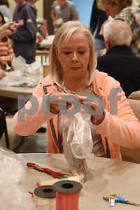 goodie bags into stockings Tuesday night at Marvin United Methodist Church.  (Sarah A. Miller/Tyler Morning Telegraph)