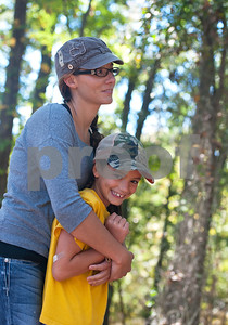 photo by Sarah A. Miller/ Tyler Morning Telegraph  Rachel Donnelly of Mineola hugs her daughter Zoe Donnelly, 9, Wednesday Oct. 29, 2014 at Mineola Nature Preserve. Donnelly's children are home schooled, and they use the park in their science lessons. Mineola Nature Preserve is 3,000 acres large and offers five miles of walking trails, 25 miles of horseback riding trails, an archery range, a canoe trail along the Sabine River and more.