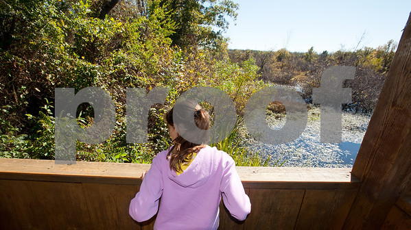 photo by Sarah A. Miller/ Tyler Morning Telegraph  Sophie Donnelly, 10, of Mineola, looks at a pond from a wildlife viewing area at Mineola Nature Preserve Wednesday Oct. 29, 2014. Mineola Nature Preserve is 3,000 acres large and offers five miles of walking trails, 25 miles of horseback riding trails, an archery range, a canoe trail along the Sabine River and more.