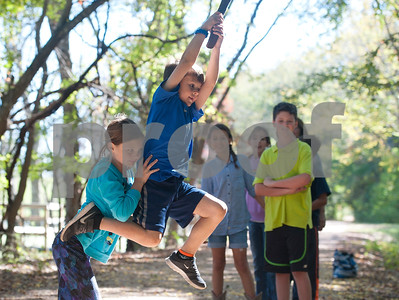 photo by Sarah A. Miller/ Tyler Morning Telegraph  nna Hall, 9, helps her brother Eli Hall, 7, swing from a vine hanging down from a large tree at Mineola Nature Preserve. Mineola Nature Preserve is 3,000 acres large and offers five miles of walking trails, 25 miles of horseback riding trails, an archery range, a canoe trail along the Sabine River and more.