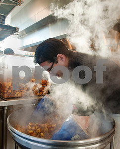 photo by Sarah A. Miller/Tyler Morning Telegraph  Fresh by Brookshire's executive sous chef Joseph Guzzetta mixes ingredients together as he makes a 300 pound batch of cornbread dressing Wednesday morning.