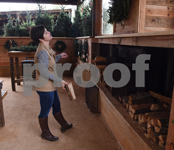 adds wood to the fireplace at Trail Creek Farm Lindale Tuesday Nov. 22, 2016. Trail Creek Farm is a Christmas tree farm that also offers family activities such as a zip line, picnic areas and bounce houses.  (Sarah A. Miller/Tyler Morning Telegraph)
