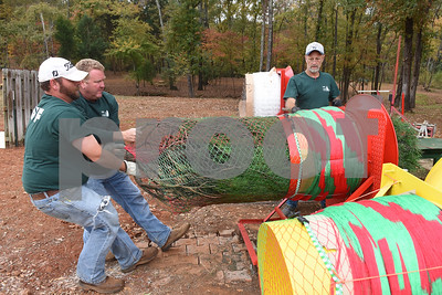 Judson Weaver, Jon Devereaux and Robert Cockrell bail a Christmas tree for a customer at Trail Creek Farm in Lindale Tuesday Nov. 22, 2016. Trail Creek Farm is a Christmas tree farm that also offers family activities such as a zip line, picnic areas and bounce houses.  (Sarah A. Miller/Tyler Morning Telegraph)