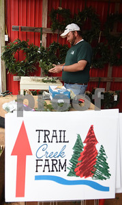 Judson Weaver makes a wreath at Trail Creek Farm in Lindale Tuesday Nov. 22, 2016. Trail Creek Farm is a Christmas tree farm that also offers family activities such as a zip line, picnic areas and bounce houses.  (Sarah A. Miller/Tyler Morning Telegraph)