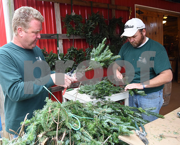Jon Devereaux and Judson Weaver put together wreaths at Trail Creek Farm in Lindale Tuesday Nov. 22, 2016. Trail Creek Farm is a Christmas tree farm that also offers family activities such as a zip line, picnic areas and bounce houses.  (Sarah A. Miller/Tyler Morning Telegraph)