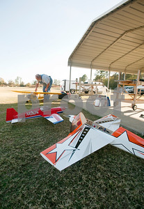 photo by Sarah A. Miller/Tyler Morning Telegraph  John Alder of Edom prepares to fly his one-fourth scale model airplane at Northside RC Airpark in Tyler Tuesday afternoon. City of Tyler staff members are making videos of Tyler's many parks and their amenities. The videos are accessible via QR codes, which are posted on signs at the parks.