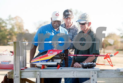 photo by Sarah A. Miller/Tyler Morning Telegraph  Don Edmonds of Tyler, center, and Bit McCray of Holly Lake Ranch, right, check out Tyler resident David Hector (pictured left) and his remote-controlled helicopter at Northside RC Airpark in Tyler Tuesday afternoon. City of Tyler staff members are making videos of Tyler's many parks and their amenities. The videos are accessible via QR codes, which are posted on signs at the parks.