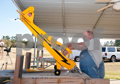photo by Sarah A. Miller/Tyler Morning Telegraph  John Alder of Edom assembles his one-fourth scale model airplane at Northside RC Airpark in Tyler Tuesday afternoon. City of Tyler staff members are making videos of Tyler's many parks and their amenities. The videos are accessible via QR codes, which are posted on signs at the parks.